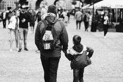 Grayscale Photography of Boy Holding Hand of Man Stock Images