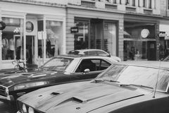 Grayscale Photography of Classic Cars Near Building Royalty Free Stock Photography