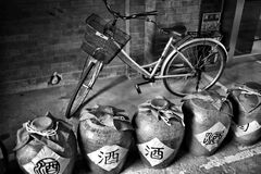 Grayscale Photography of Dutch Bike Behind Jars Royalty Free Stock Photo