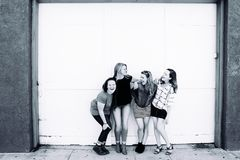 Grayscale Photography of Four Women Wearing Clothes Stock Photography