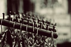 Grayscale Photography of Hangers on Rack Royalty Free Stock Images