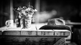 Grayscale Photography of Hat on Wooden Table Royalty Free Stock Images