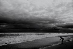 Grayscale Photography of Human Standing Near Seashore Royalty Free Stock Images