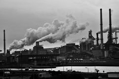 Grayscale Photography of Locomotive Train Beside Factory Royalty Free Stock Image