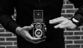 Grayscale Photography of Man Holding Rolleicord Camera Stock Photos