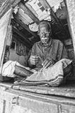 Grayscale Photography of Man Sewing Cloth Royalty Free Stock Photography