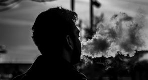 Grayscale Photography of Man Smoking Royalty Free Stock Photos