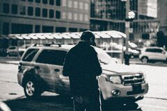 Grayscale Photography of Man Standing Near Suv during Daytime Royalty Free Stock Image