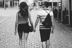 Grayscale Photography Of Man And Woman Holding Hands While Walking stock photos