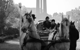 Grayscale Photography of Man and Woman Riding Carriage stock images