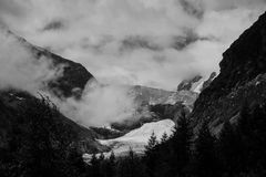 Grayscale Photography of Mountain Covered With Fogs Royalty Free Stock Photos