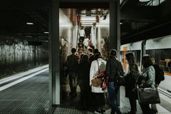 Grayscale Photography of People Falling in Line at Train Station Royalty Free Stock Photography