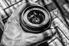 Grayscale Photography of Person Holding Dslr Zoom Lens Royalty Free Stock Photo