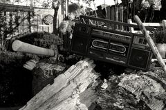 Grayscale Photography of Radio on Tree Trunk With Axe stock photography