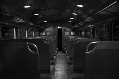 Grayscale Photography of Train Car Interior Stock Photo