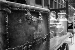 Grayscale Photography of Travel Case With Milk Churns on Trailer Royalty Free Stock Photo
