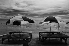 Grayscale Photography of Two Picnic Tables on Seashore Royalty Free Stock Images