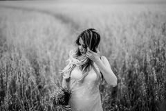 Grayscale Photography of Woman in Floral Scoop Neck Tank Top Surrounded by Wheat Field Royalty Free Stock Images