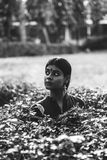 Grayscale Photography of Woman on Garden stock image
