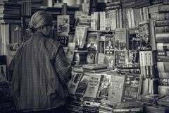 Grayscale Photography of Woman Looking at the Books royalty free stock photography