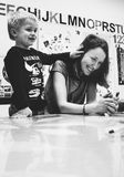 Grayscale Photography of Woman Smiling Near Kid in Black Sweater royalty free stock photography