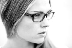 Grayscale Photography of Woman Wearing Eyeglasses stock photography