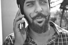 Grayscale Portrait Photo of Man Holding Phone Stock Images