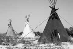 Grayscale teepees. On the sea shore stock photography
