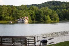 Houseboat In Kentucky. Grayson, Kentucky, USA - June 12, 2015: Luxurious houseboat complete with waterslide on Grayson Lake in the Appalachian Mountains of Royalty Free Stock Photos