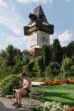 Low angle view of Uhrturm clock in Graz stock images