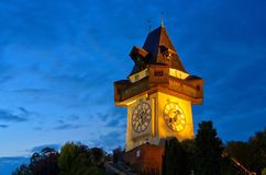 Graz clock tower by night Royalty Free Stock Images