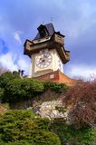 Graz Styria Austria. Old clock tower in Graz, landmark of the city Austria, center city, schlossberg, family picture doing Royalty Free Stock Photography