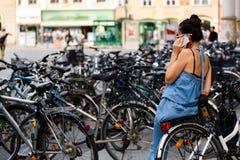 Woman talks on mobile phone Stock Photo