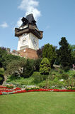 Clock tower on Castle Hill in Graz. Scenic view of clock tower and landscaped gardens on Castle Hill, Schlossberg, Graz, Austria Stock Photo