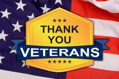 Grazie distintivo dei veterani con la bandiera degli Stati Uniti nel fondo Immagine Stock Libera da Diritti