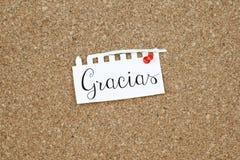 Grazie nota del messaggio nella lingua spagnola Immagini Stock