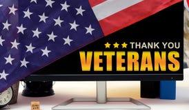 Grazie veterani con il monitor della bandiera degli Stati Uniti Fotografia Stock Libera da Diritti