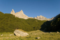 Grazing area and boulder in the french Pyrenees Stock Photo