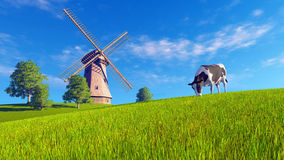Grazing mottled cow and windmill Royalty Free Stock Image