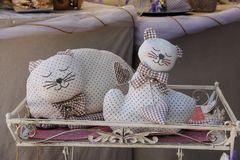 Decorative sleeping cats in souvenir shop in Grazzano Visconti, stock images