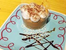 gream cake,Tiramisu on the plate on the wooden background stock photos