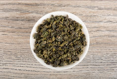 Grean tea leaves on table Royalty Free Stock Photography