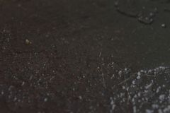 Grease pan texture. A detailed photo of a grease pan with cooking oil stock photography