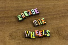 Grease wheels learning education help speed up phrase. Grease wheels learning education help speed up fast faster service phrase letterpress typography royalty free stock photos