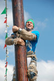 Greased pole climber Royalty Free Stock Photos