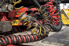 Greasy cables connecting truck and trailer Royalty Free Stock Image