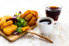 Greasy fried chicken, french fries, ketchup and salad. Stock Images