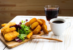 Greasy fried chicken, french fries, ketchup and salad. Royalty Free Stock Photos