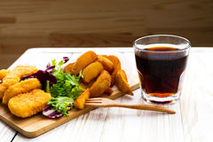 Greasy fried chicken, french fries, ketchup and salad. Royalty Free Stock Photography