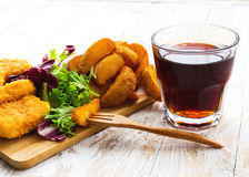 Greasy fried chicken, french fries, ketchup and salad. Royalty Free Stock Images